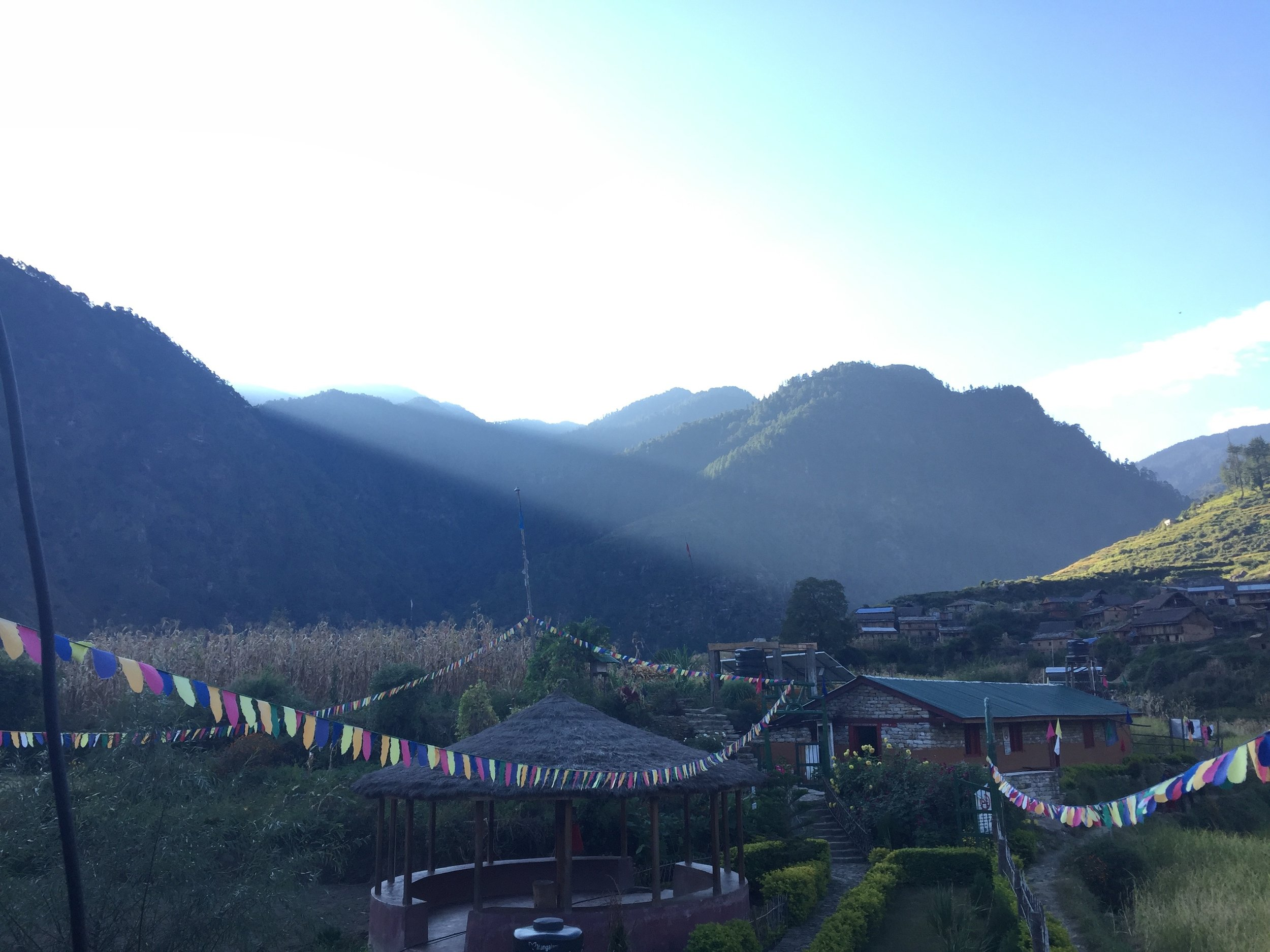 One of my favorite views of Oda, looking of the back deck of the medical clinic as the sun rises over the mountains to the East, slowly illuminating the village