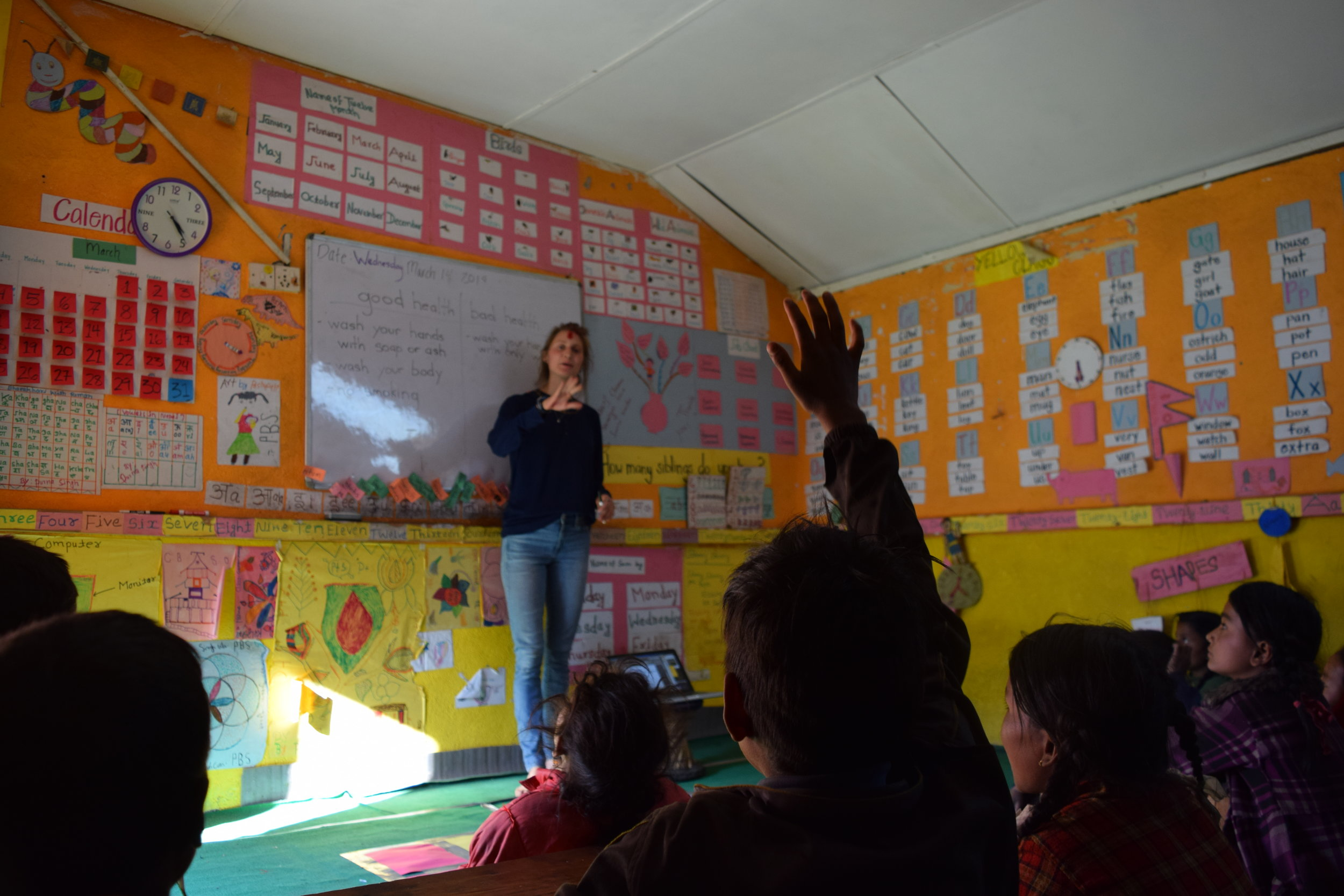 Sarah teaching her weekly health class in our tuition classroom