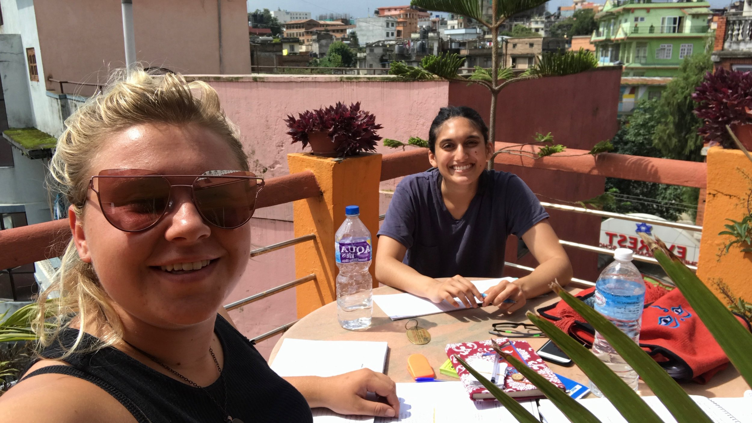 Fellows Lucy and Radha studying Nepali on the rooftop of their Kathmandu hostel