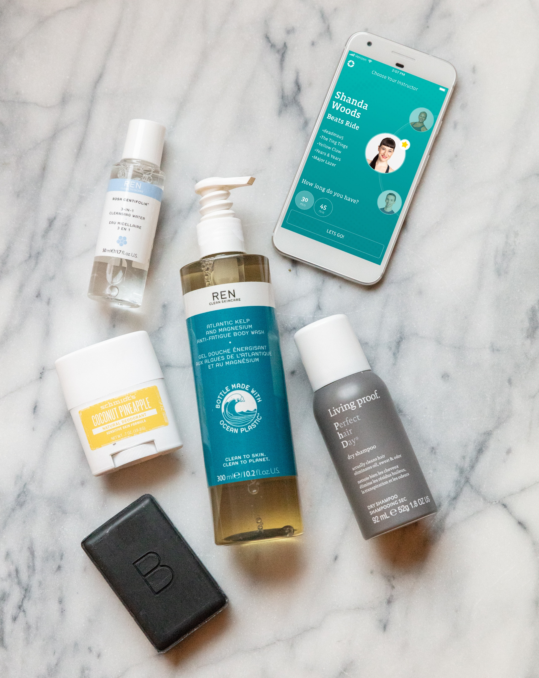 From top to bottom: REN Skincare Rosa Centifolia™ 3-in-1 Cleansing Water, REN Skincare Atlantic Kelp & Magnesium Anti-Fatigue Body Wash, Schmidt's Deodorant in Coconut Pineapple, Living Proof Perfect Hair Day Dry Shampoo, Beautycounter Charcoal Cleansing Bar