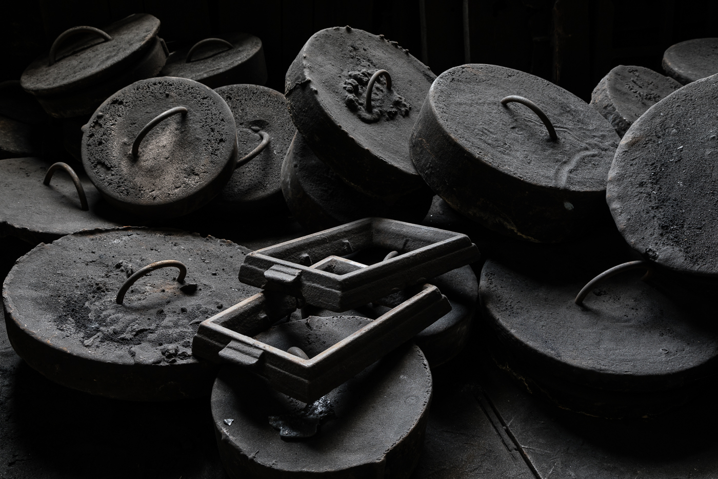 Discs on the Floor of a Foundry