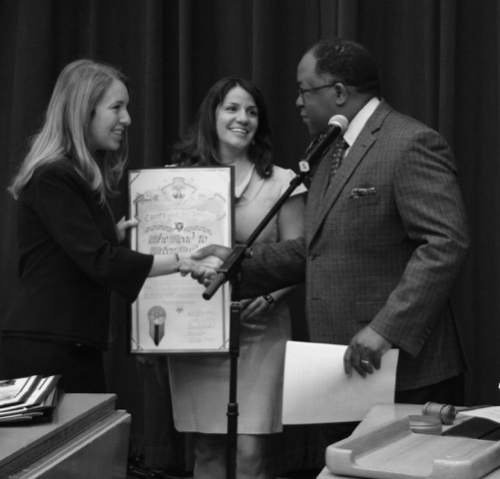 USGBC-LA's Dominique Smith and Argento/Graham's Annie Argento accept the award from LA County Supervisor, Mark Ridley-Thomas.