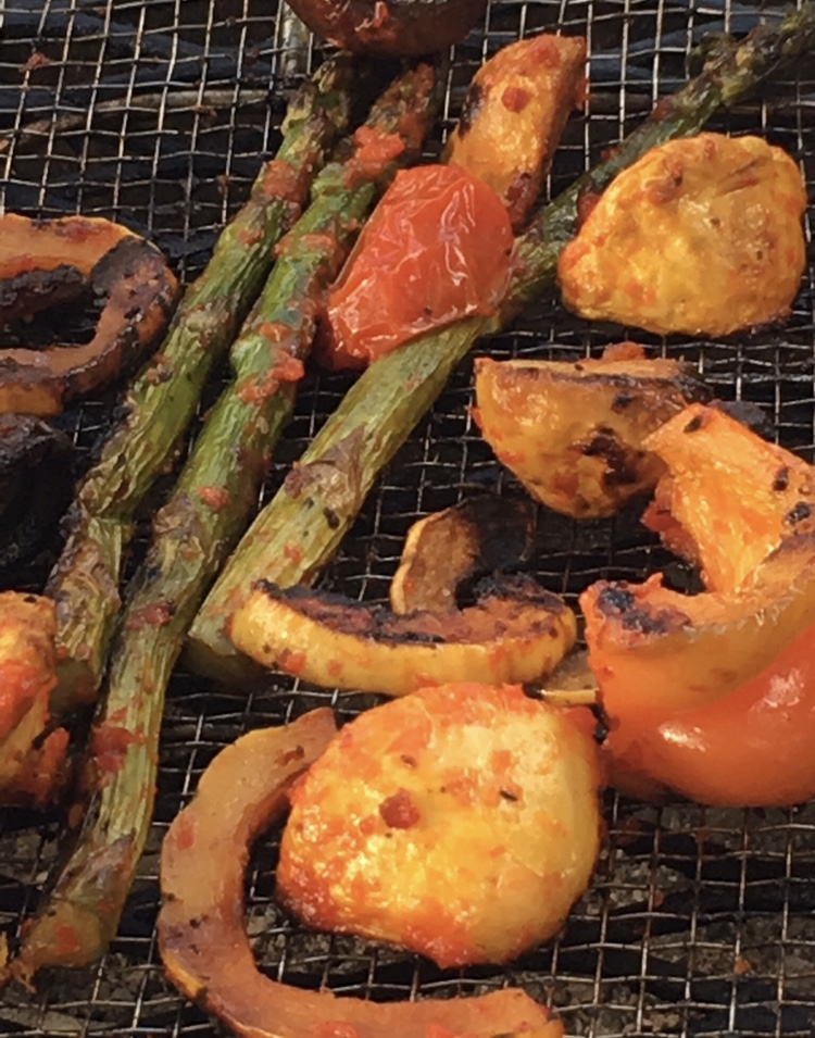 Fresh vegetables roasting on the grill in a fresh red pepper jam. Some great vegetarian/vegan options straight off the flame.