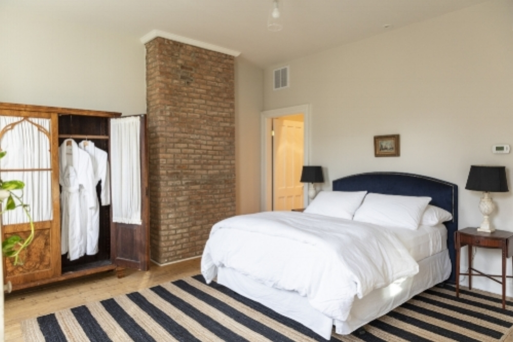This romantic room with two large windows overlooking the village, features a queen bed and an antique armoire. - 285 sq ft$249.00 per night for up to 2 people