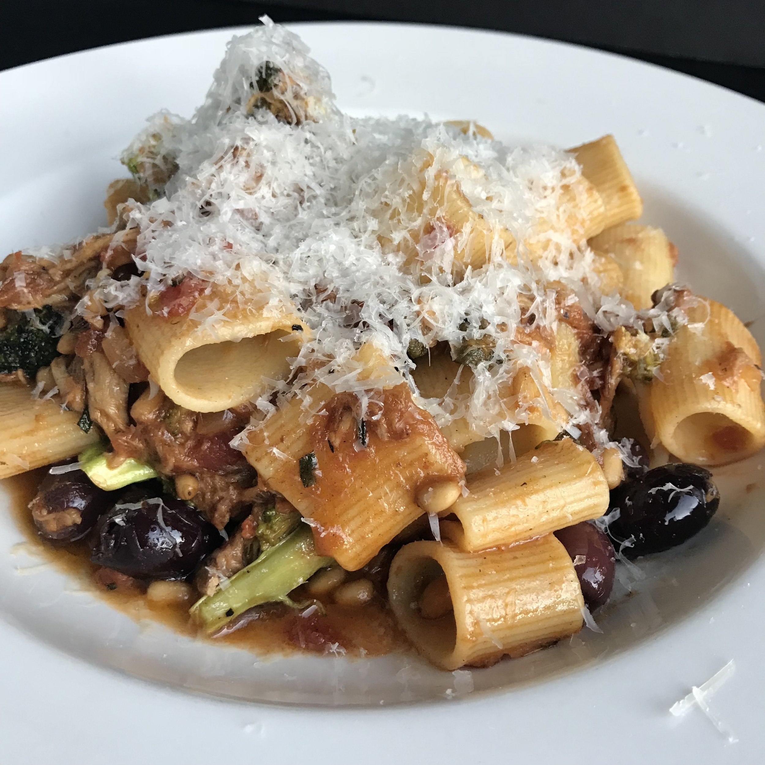 rigatoni, broccoli, olives, capers, pine nuts, and slow roasted pork ragu with parmesan