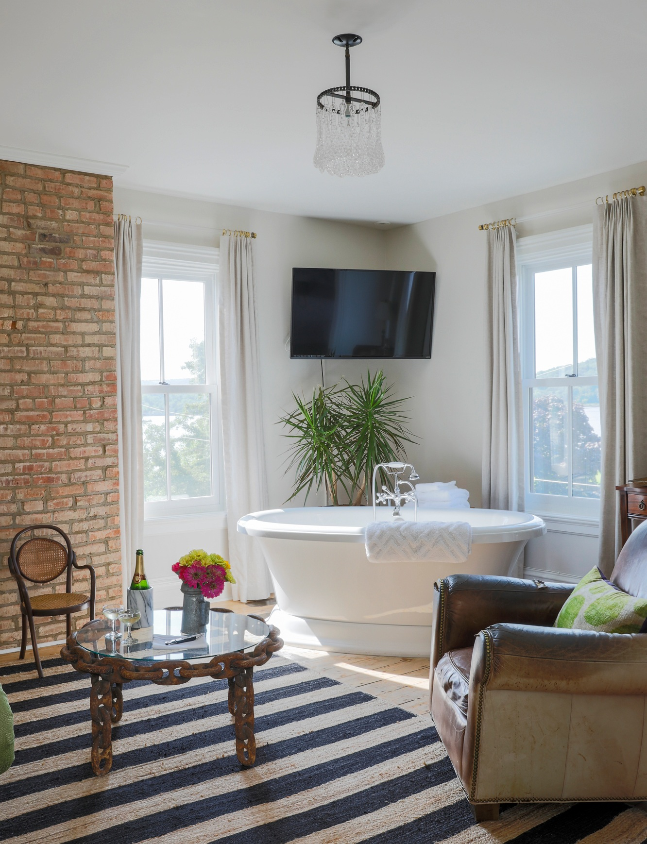 This large romantic suite boasts a living room with large soaking tub with a view of the Hudson and a separate bedroom with king size bed. - 400 sq ftPlease note this room is a 3rd floor walkup$349.00 per night for up to 2 people
