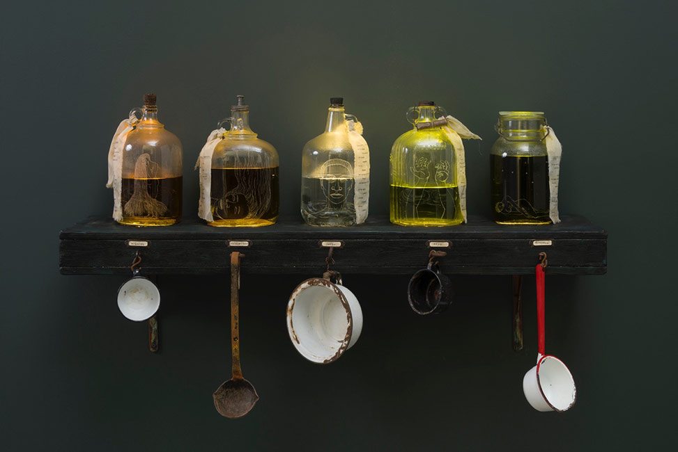 Alison Saar / Hades D.W.P., 2016 / etched glass jars, water, dye, wood, cloth and ink transfer, electronics, found ladles and cups / 30 x 50 x 16 in. (76.2 x 127 x 40.6 cm) / Poetry by Samiya Bashir / Private collection  As exhibited at L.A. Louver, 2016