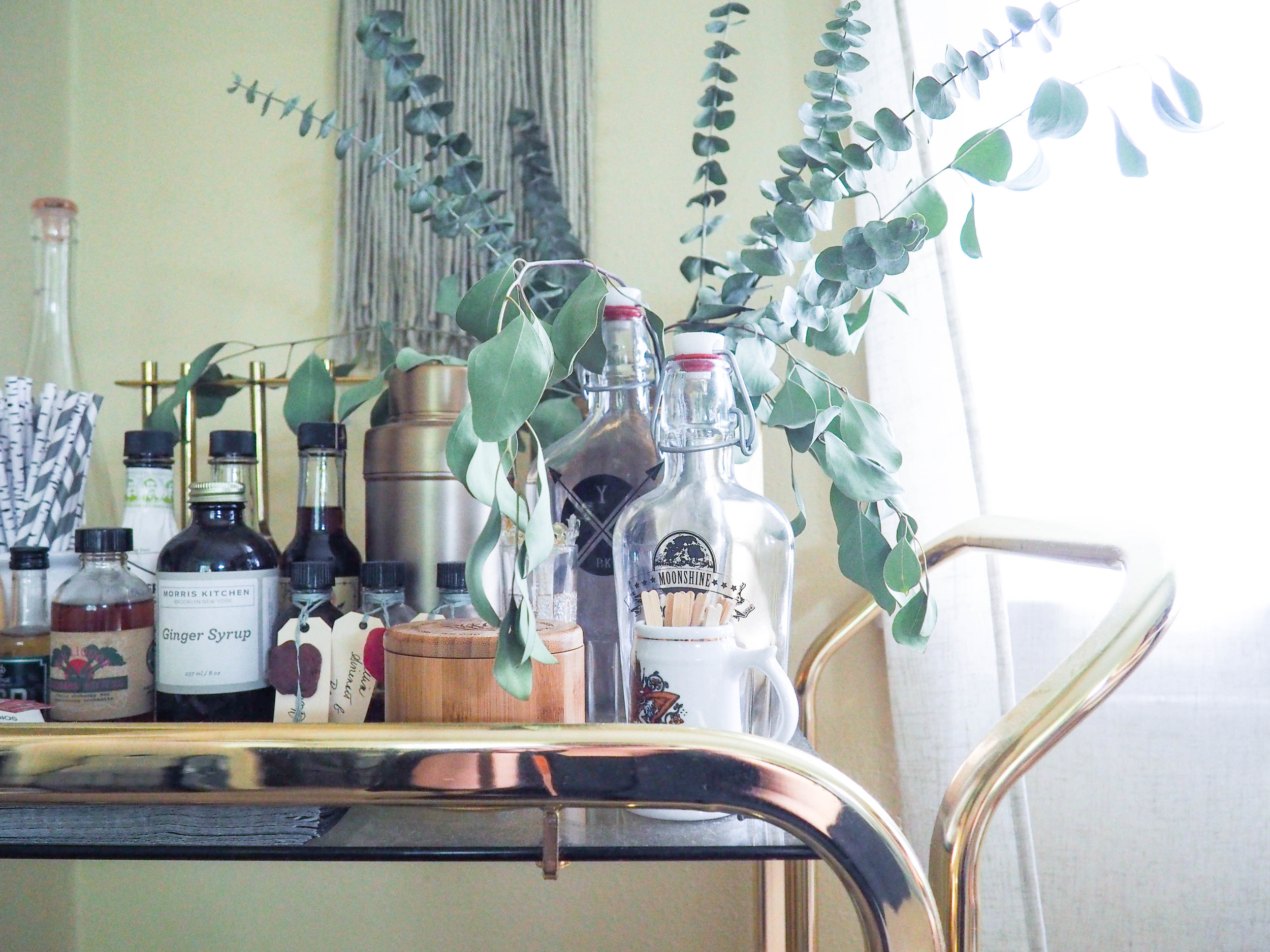 A vintage brass bar cart that I purchased ages ago. It has the perfect amount of wear and patina.