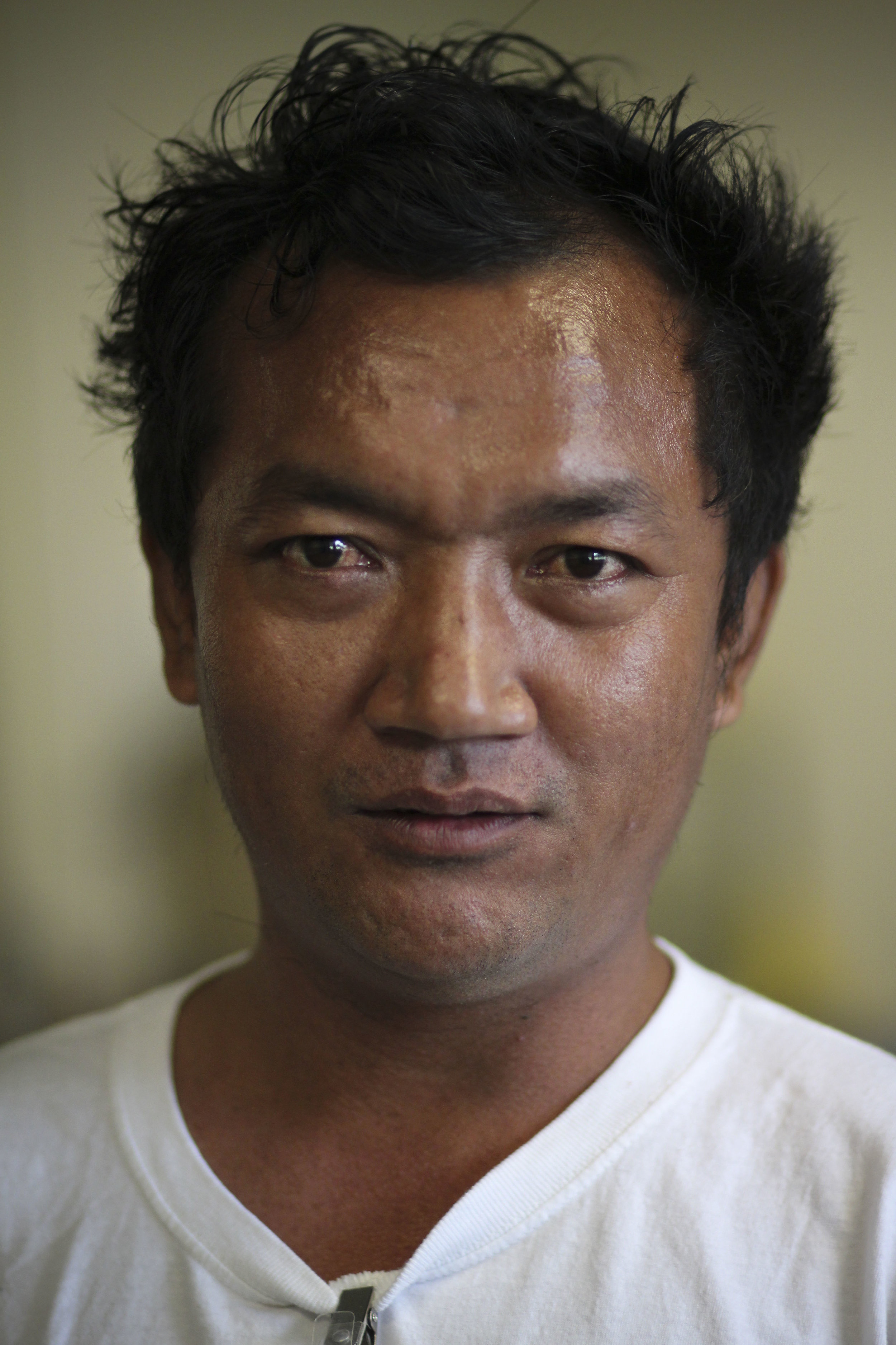 """I came from Burma to Nepal and from Nepal to the United States. I grew tired with the regime and the soldiers kept coming to catch me and I was frightened, so I left my home country.""  Are you happy here? ""Yes, I am so happy here.""   Why? ""Freedom."""
