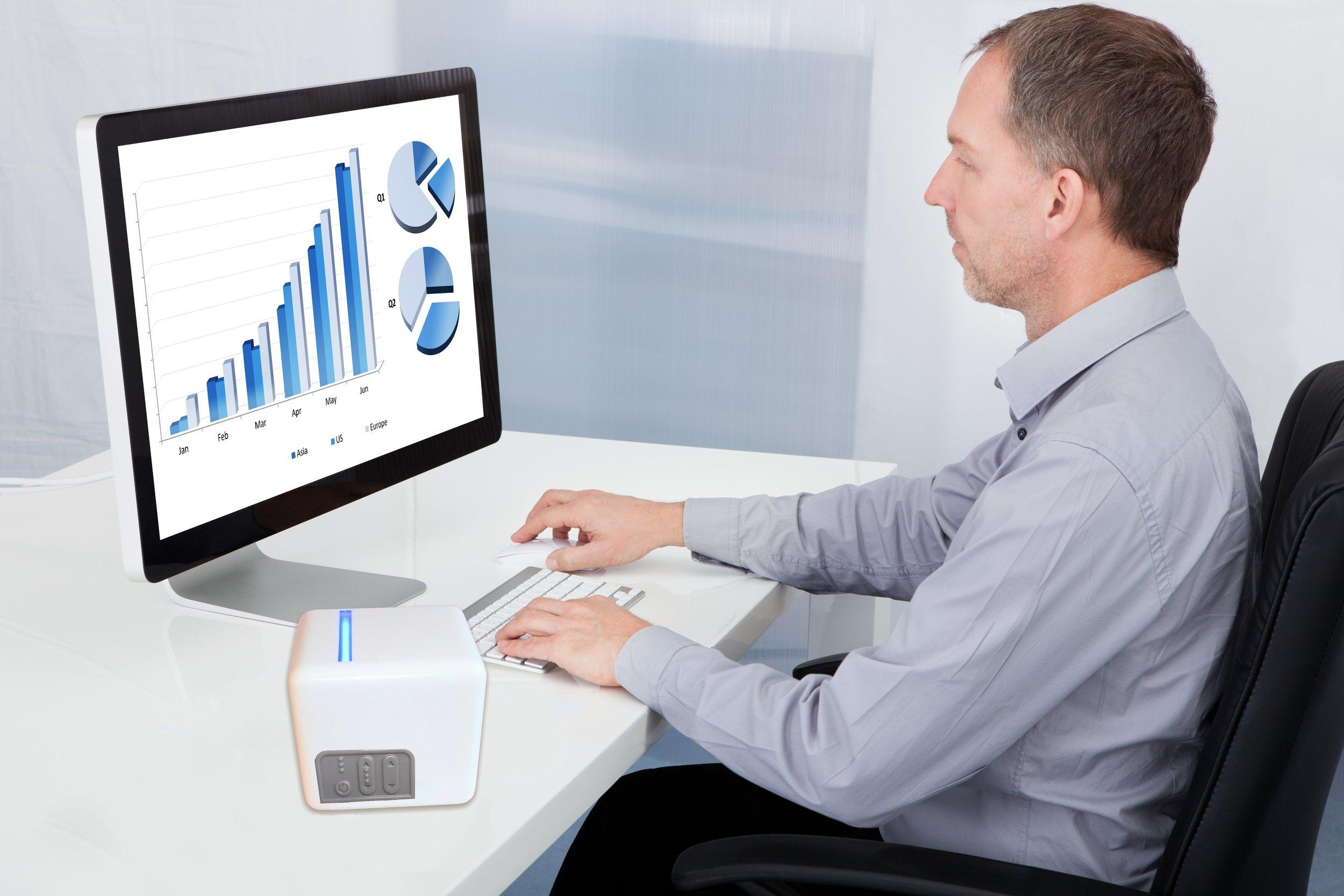 Man at Desk w Cube.jpg