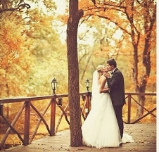 Couple Kissing Outside Among Fall Trees.jpg