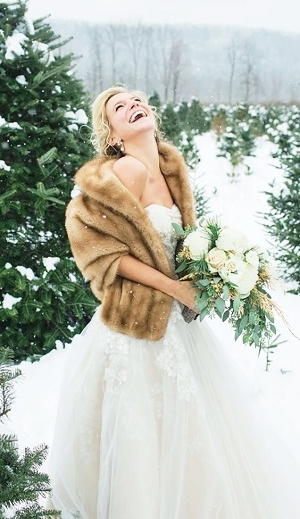 Laughing in the Snow in Light Brown Faux Fur Stole.jpg