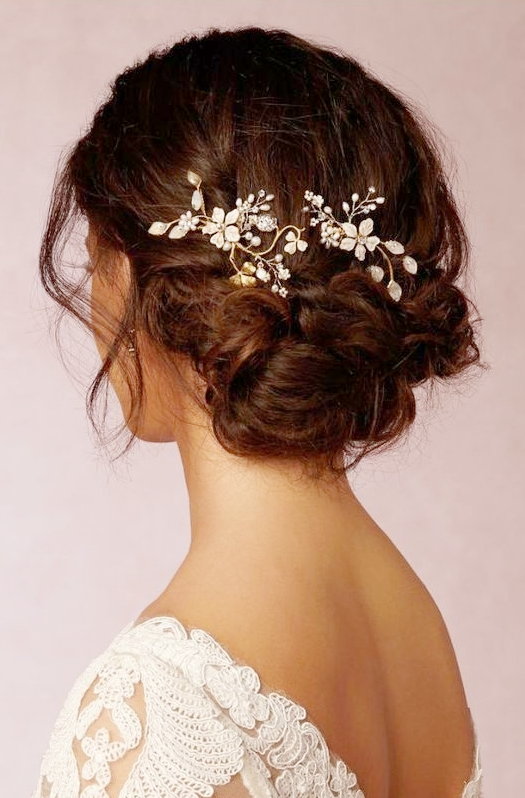 Dark-Haired Loose Side Bun with Flower Metal Accessory.jpg