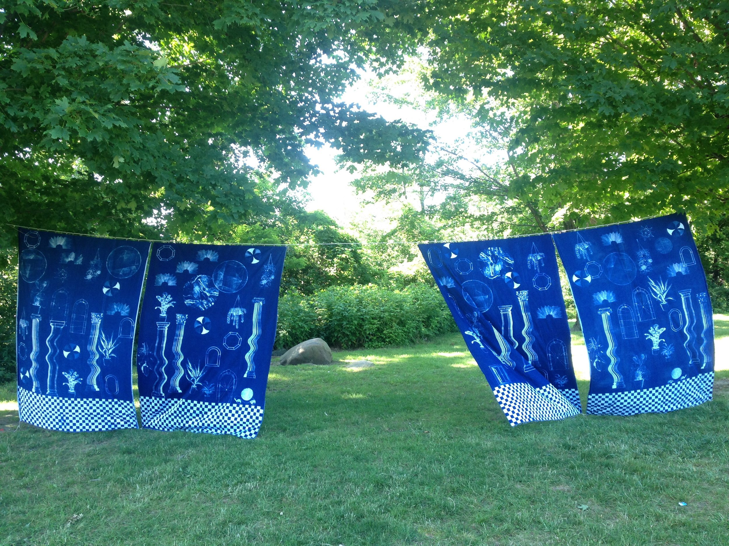 a place halfway between both worlds where anyting can happen and there is no problem with time  Cyanotype sun printed curtains, each 5' x 7'  Feast in the East, Praire Drive park, Scarborough   2017