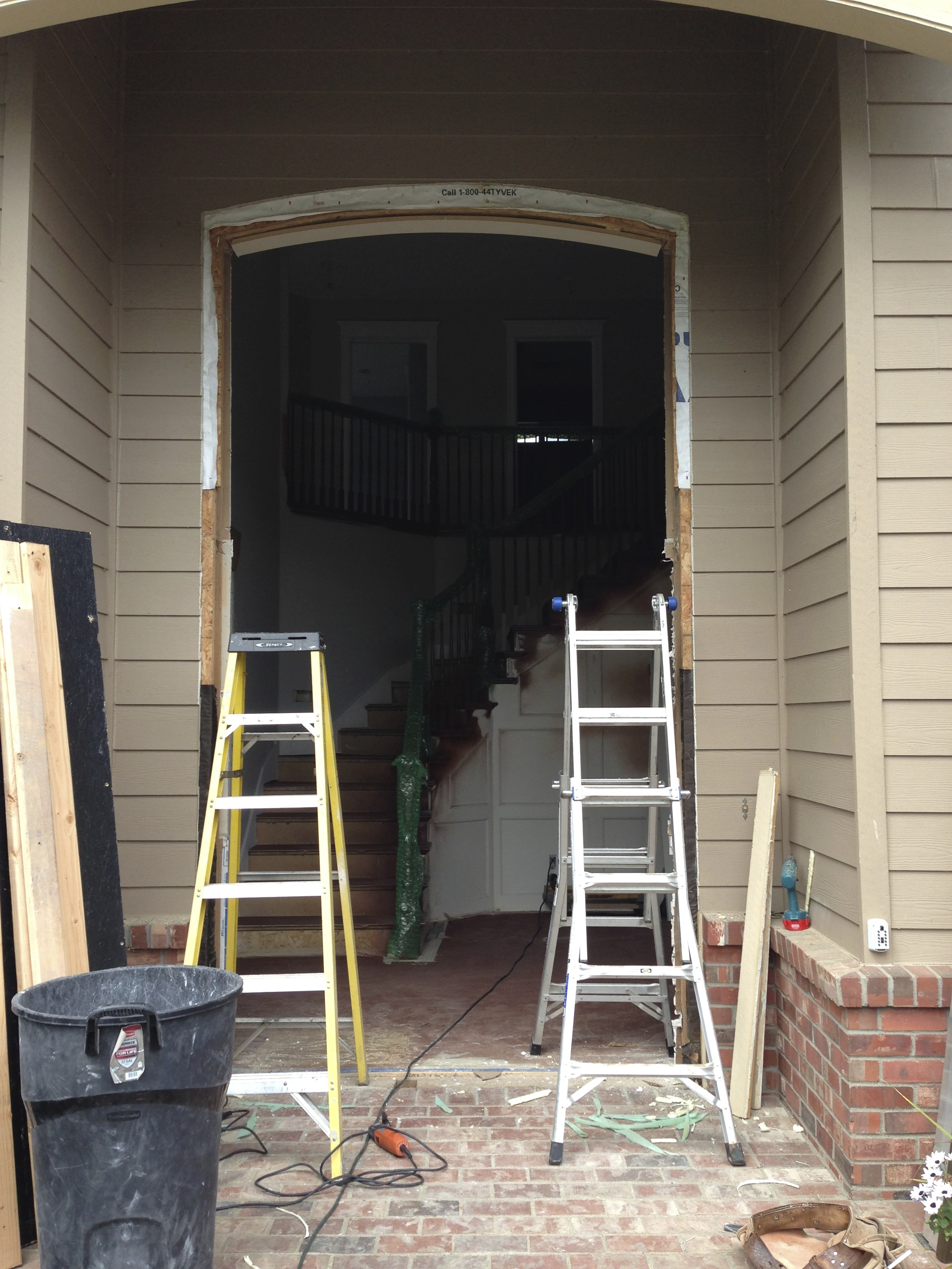 Removing the old window and preparing the space for the new door.