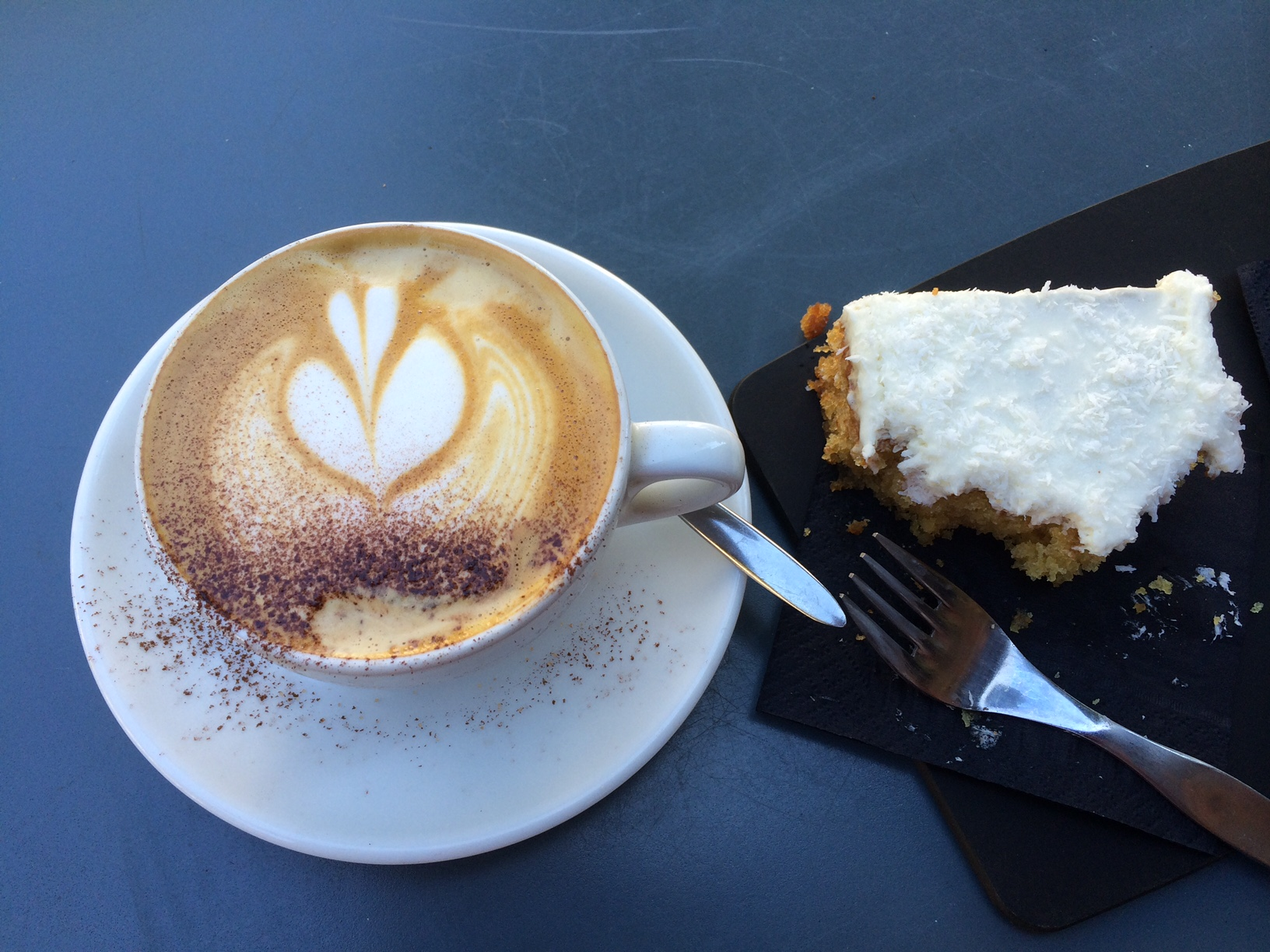 Coffee and cake at an outdoor cafe