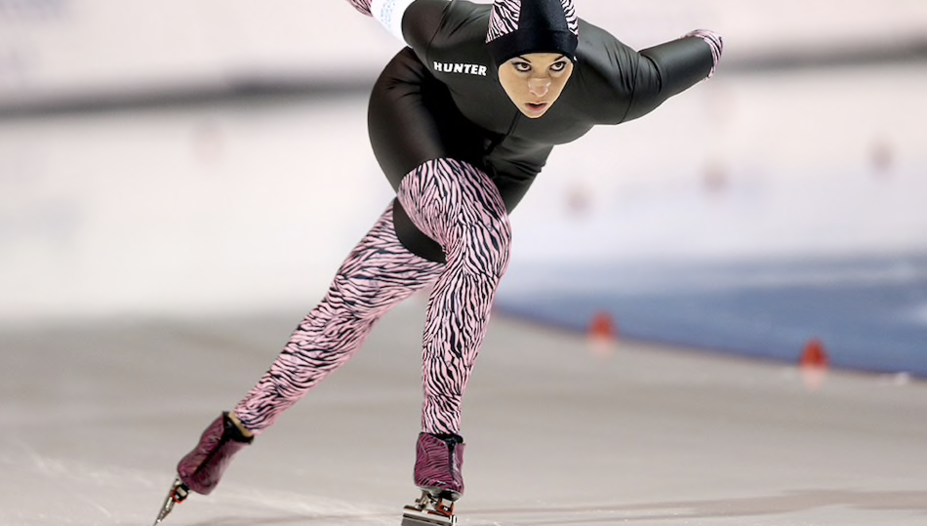 Photo:  Getty Images, Allison Baver, Short Track Olympic Bronze Medalist makes history as the first female to compete in both the a Short Track and Long Track Speed Skating Olympic Trials for the same Olympic Games, 2014.