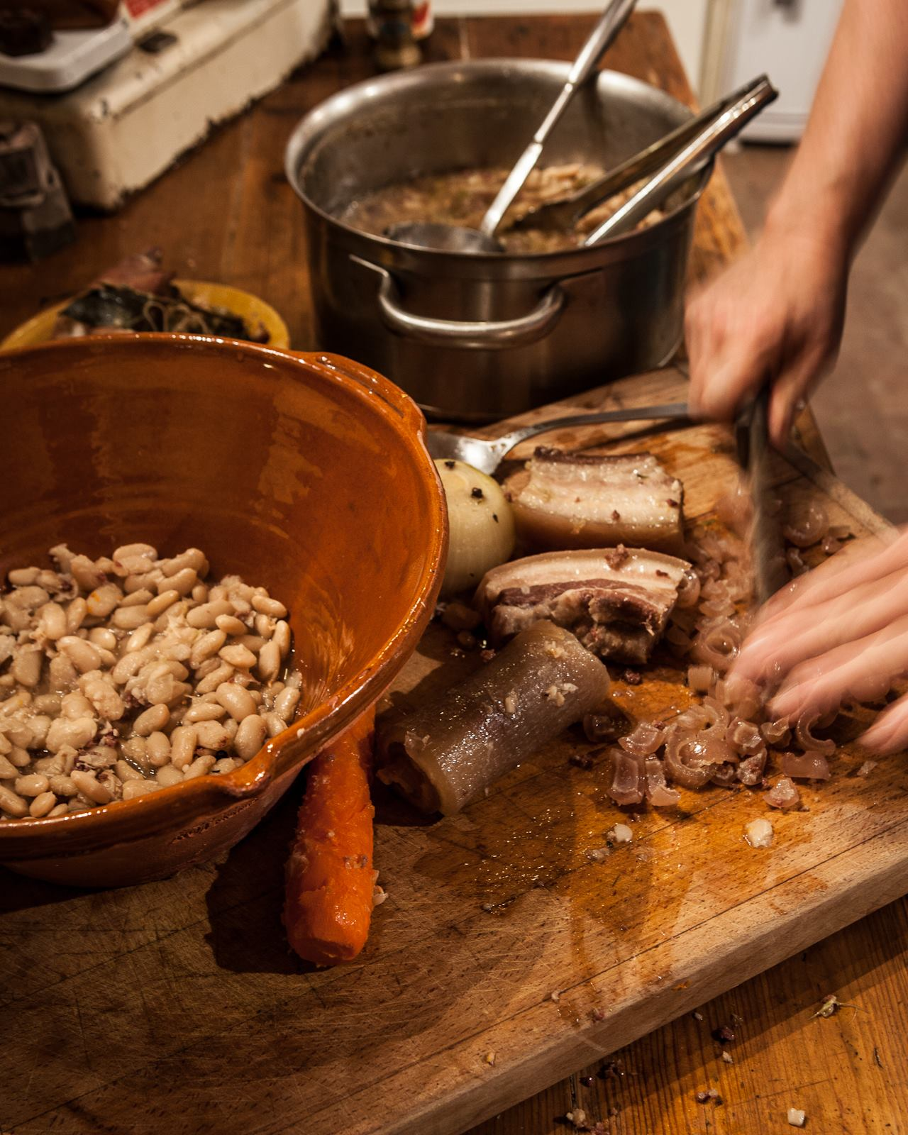 photo:  Tim Clinch    Kate prepares cassoulet in the  Kitchen at Camont .