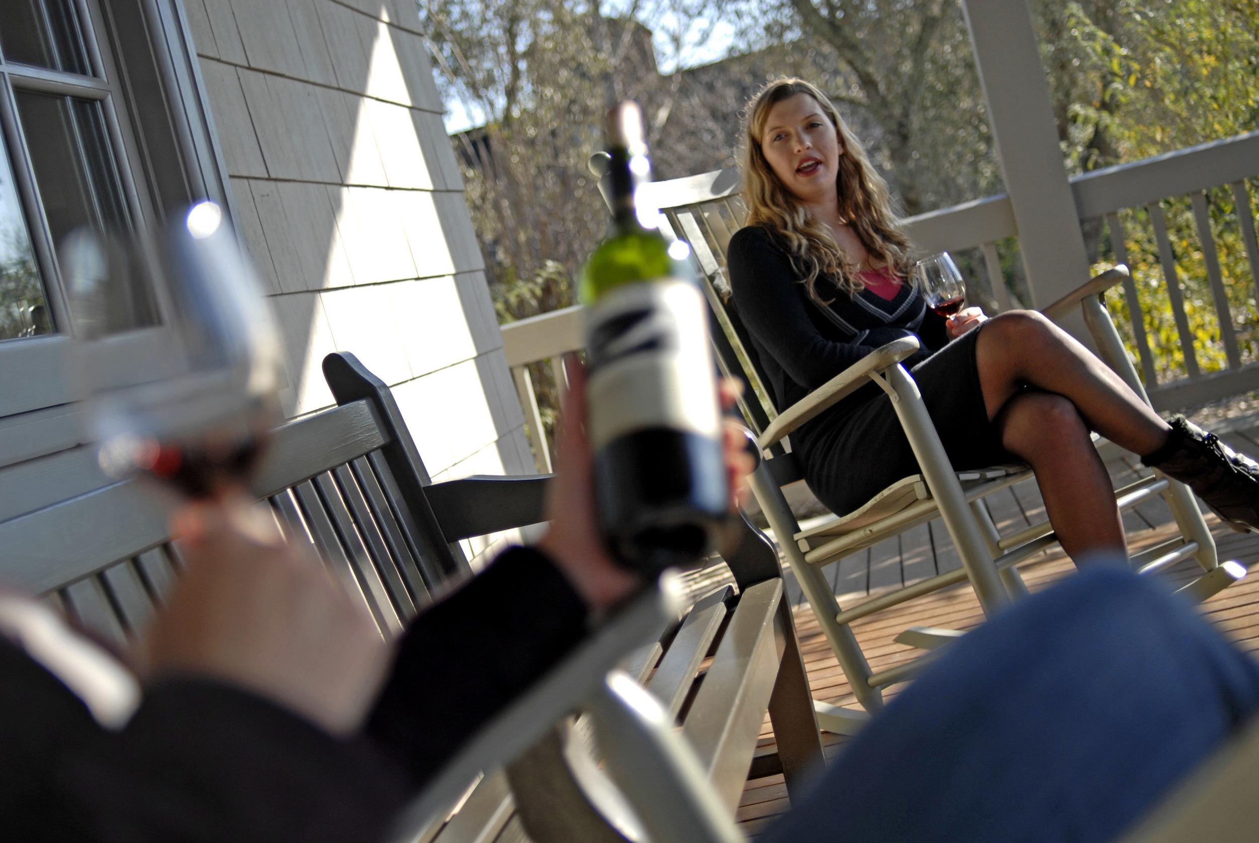 Drinking wine at Frog's Leap vineyard porch-2.jpg