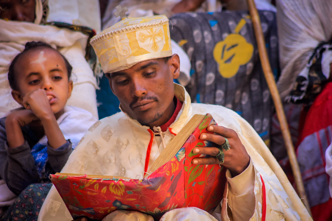 A DEACON      studies scripture before a reading to hundreds of worshipers at the St. George church in Lalibela the week before Easter