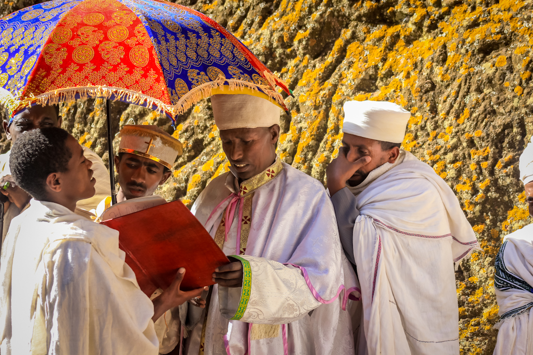 DEACONS read scripture before hundreds of worshipers at the St. George church in Lalibela the week before Easter.