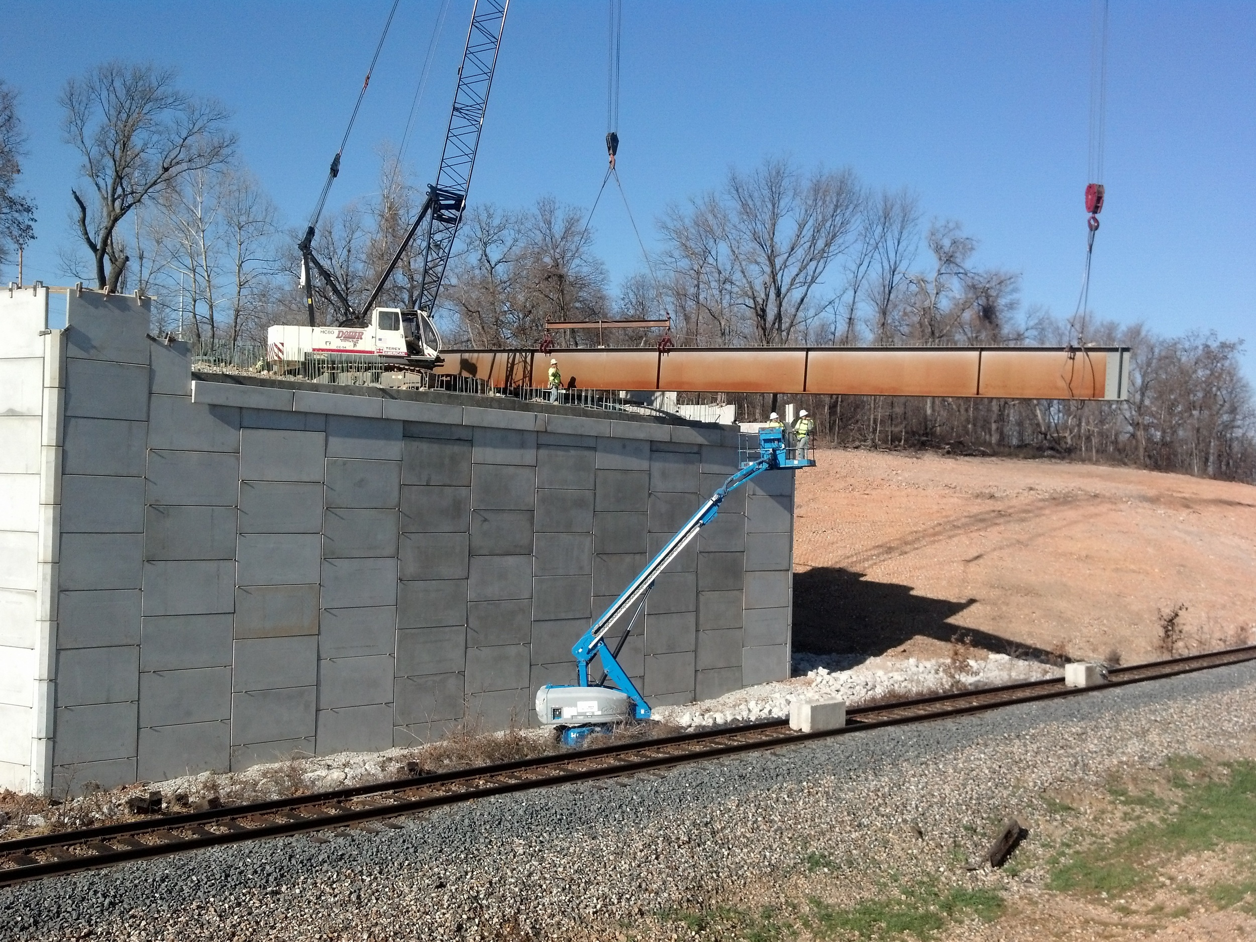 Joplin Rte. 43 Zora setting beams over KCSRR.jpg