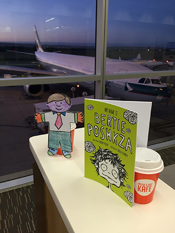 Bertie waiting to board his flight to the USA – he takes along his new friend