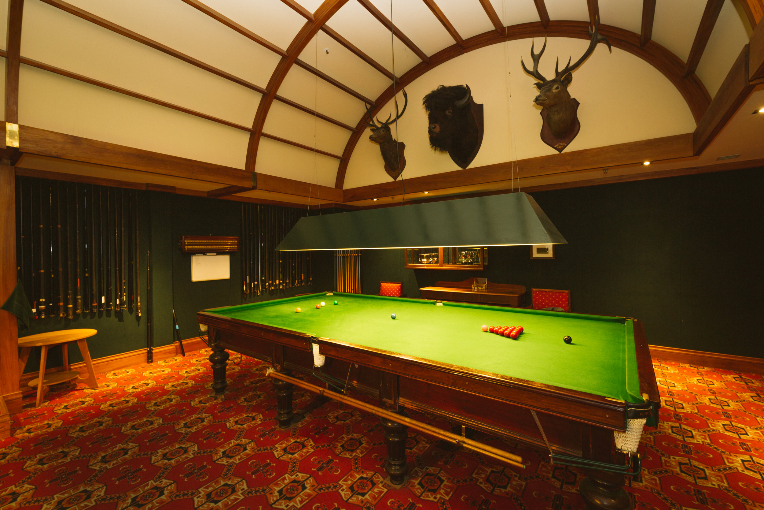 Billiard Room back table with deer heads.jpg