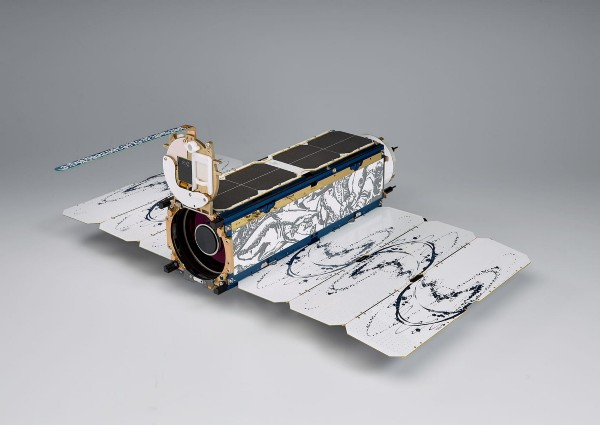 Dove Satellite covered in artworks. Photograph by Carter Dow