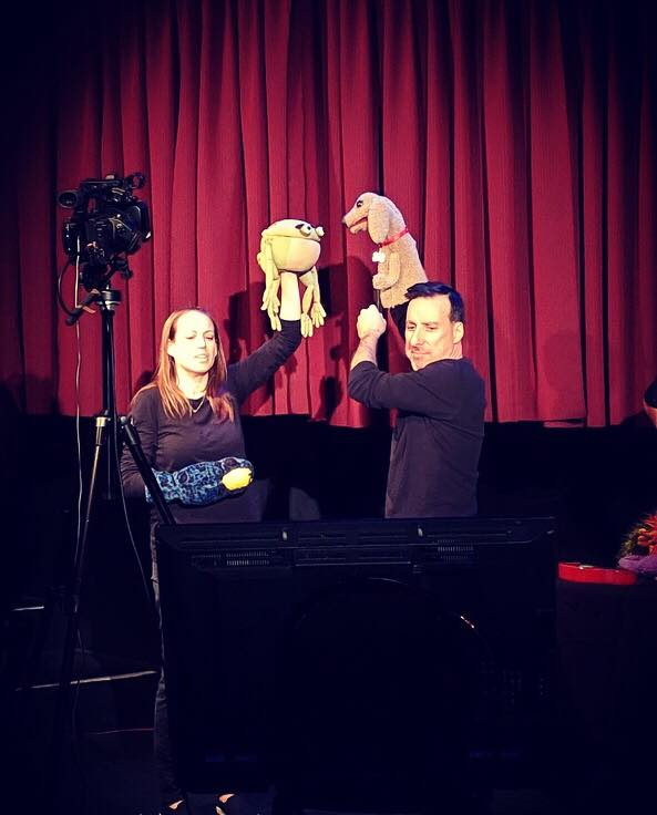 Emily Davis and Dave Jadico improvise a scene while watching the puppets on the monitor.