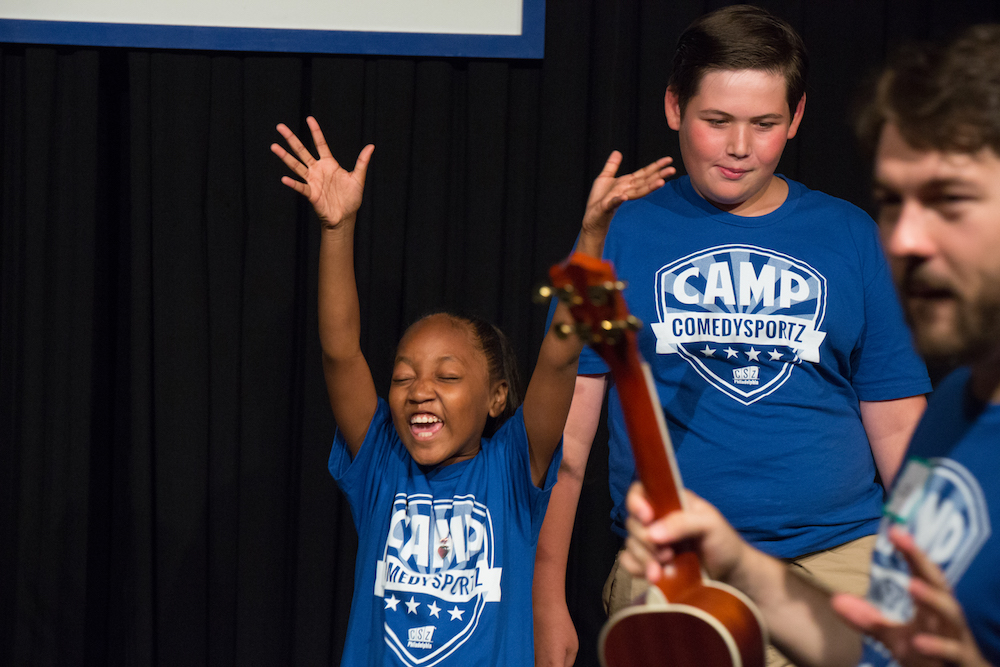 Campers also learn singing games.