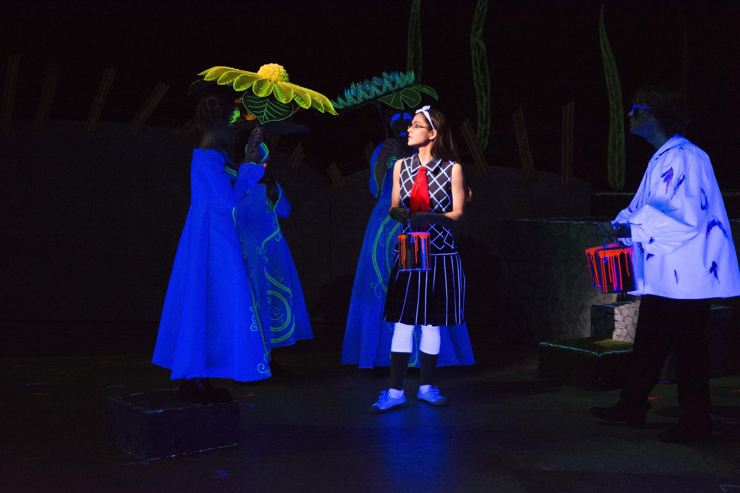 Carlie Campos Ott stars as Alice (center)