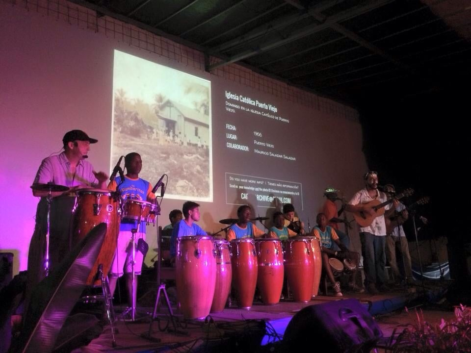 Los Icebreakers perform with Los Rumberitos while photos from the South Caribe Roots Archive display on the screen behind. Hot Rocks, Puerto Viejo, August 2015.