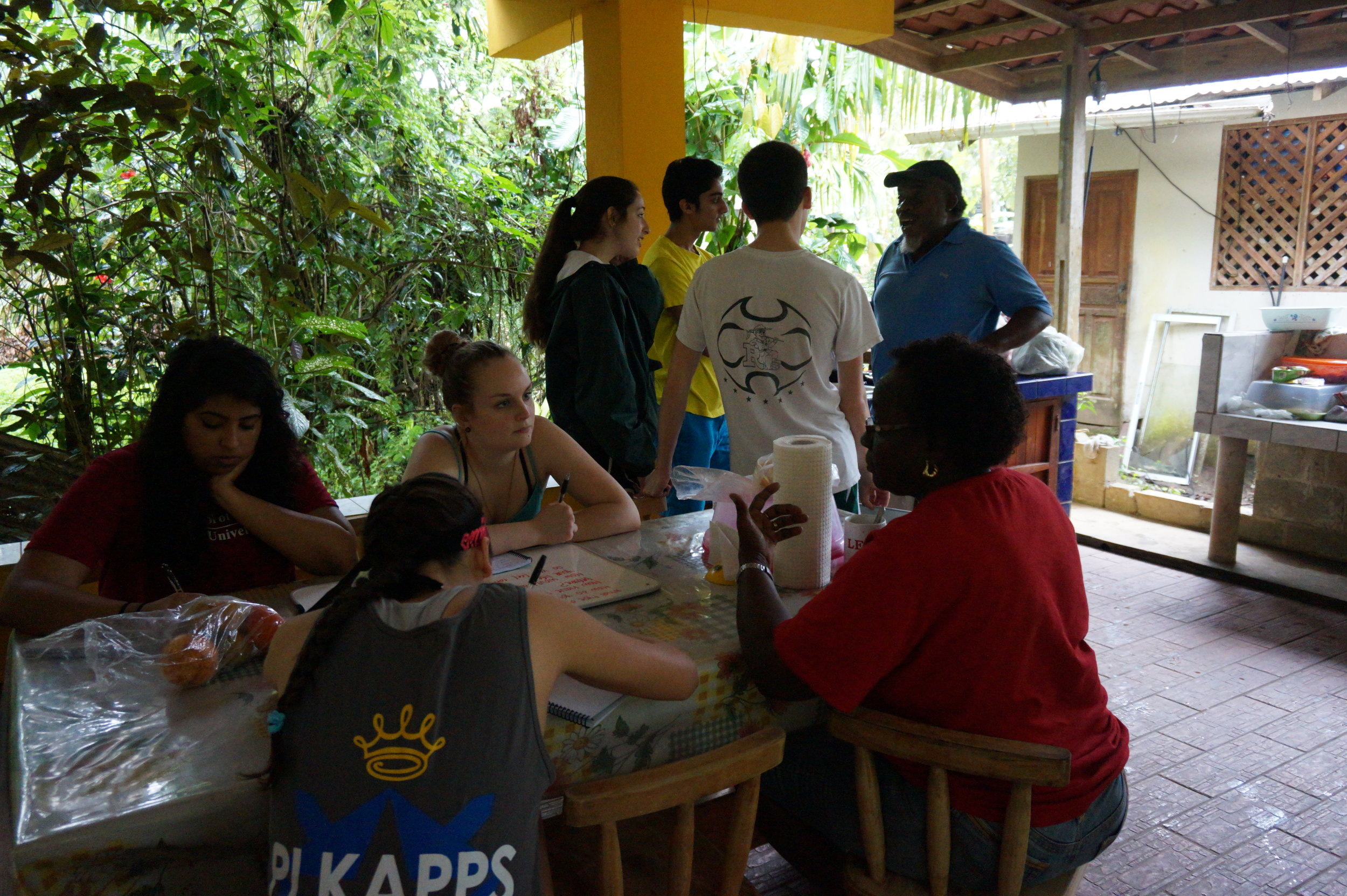 Students from Indiana University's Kelley School of Business interview Manzanillo residents Ethlyn Weir and Dennis Clark as part of the Alternative Spring Break collaboration with Kelley Initiatives for Social Impact.
