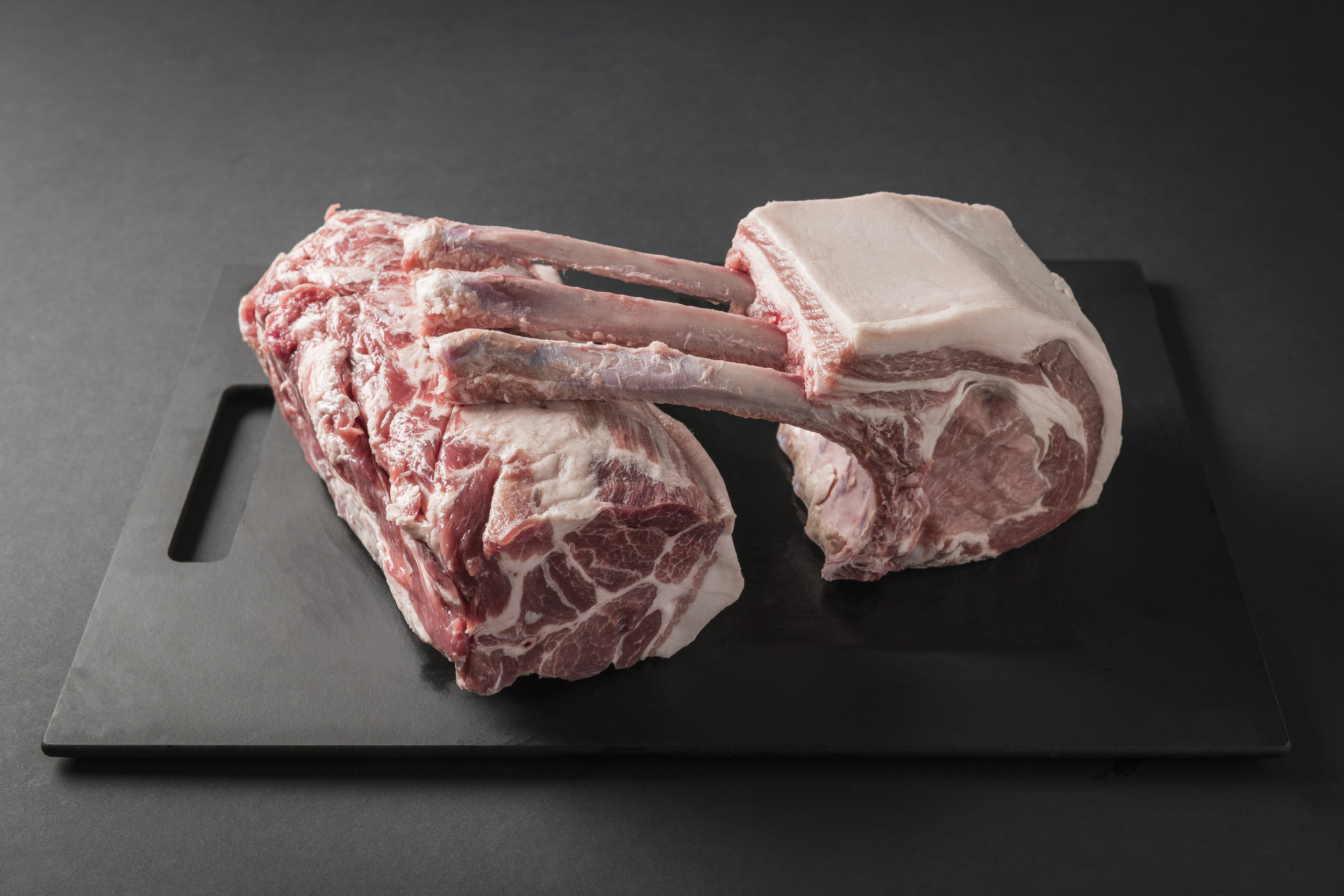 Japanese Saga Buta - We source our Japanese pork from the Saga Prefecture, thus the name Saga-Buta; Buta being the Japanese word for pork. They are raised along the Midori Mountains which overlook the Arkiake Sea. A white skinned pig that is composed of various breeds like Duroc, Middlewhite and Landrace, they were bred to produce superior pork that is also high in Vitamin B1. The farmers dedication to produce quality pork goes hand in hand with their desire to raise the pigs to be healthy well cared for animals.