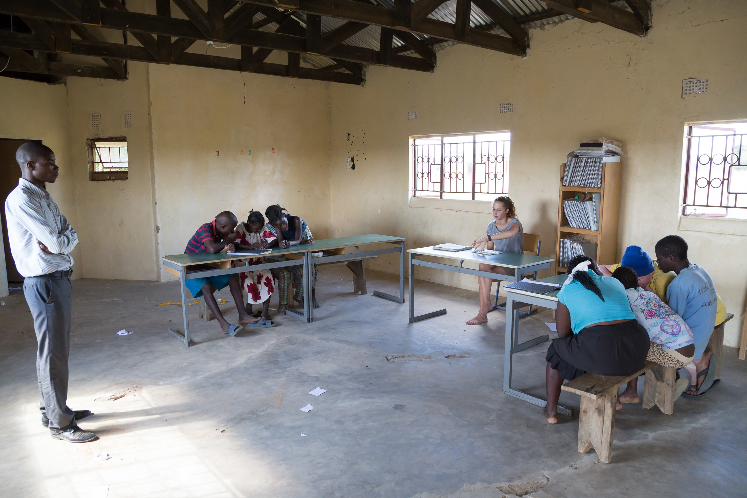 Mr. Masasa overseeing the classroom debate. Which is better - Pasta or Soya?