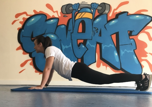 Incorrect form - head up, lower back arched.