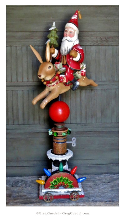 Santa riding a rabbit by Greg Guedel. Carved wood, salvage wood and vintage finds