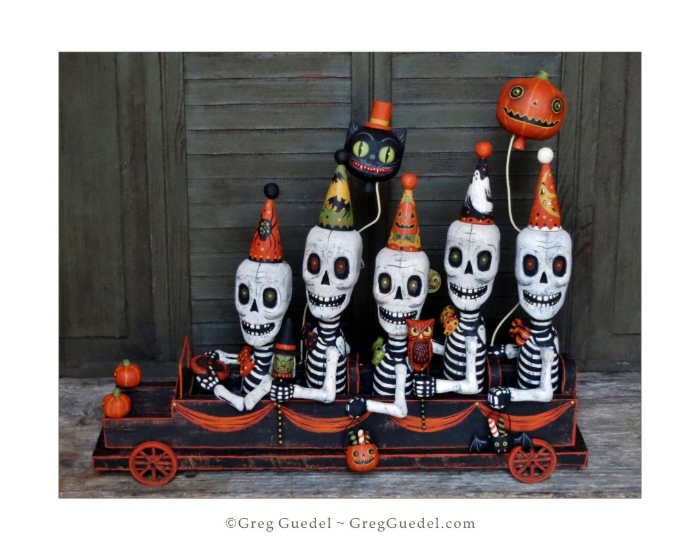 Skeleton's Halloweenmobile Greg Guedel wood carving.JPG