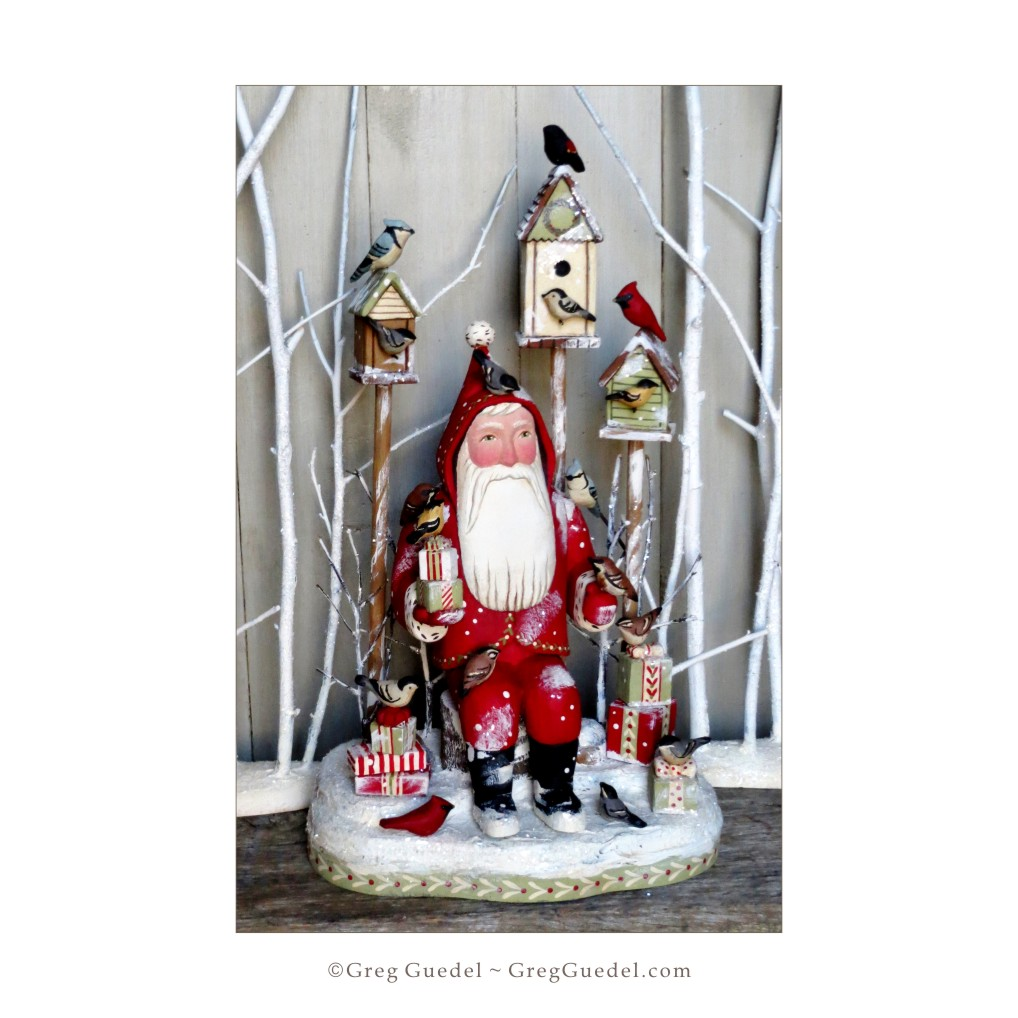 Greg Guedel ~ Bird Lover Santa wood carving.JPG