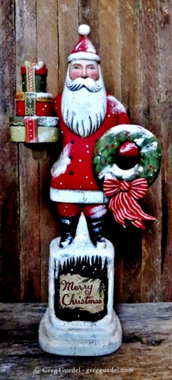 Merry Christmas Santa with wreath ~ wood carving by Greg Guedel.JPG