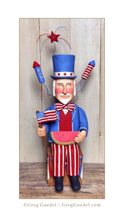 Uncle Sam on the 4th of July - wood carving by Greg Guedel.JPG