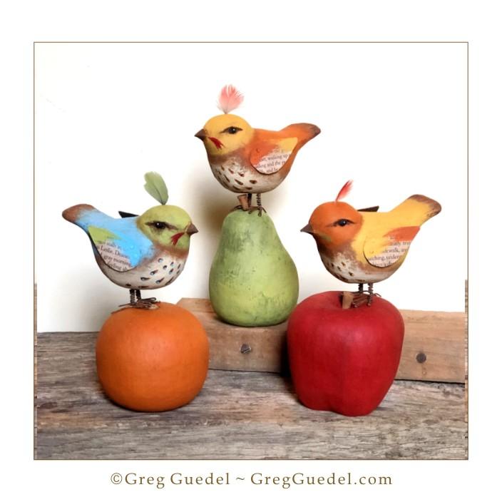 Folk art birds on fruit wood carvings by Greg Guedel.JPG