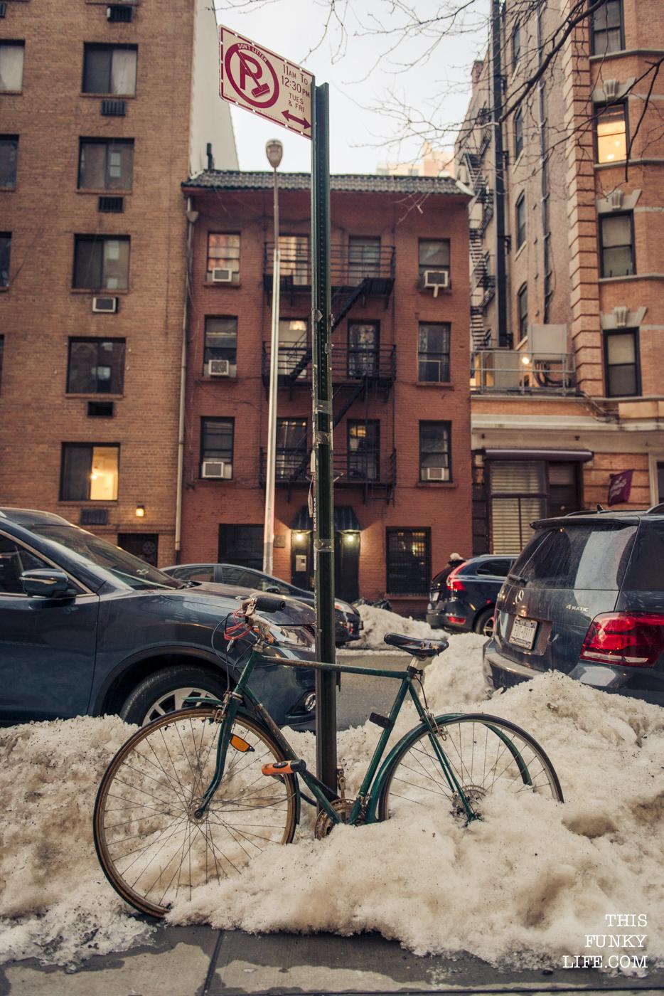 A bike buried in snow in Manhattan