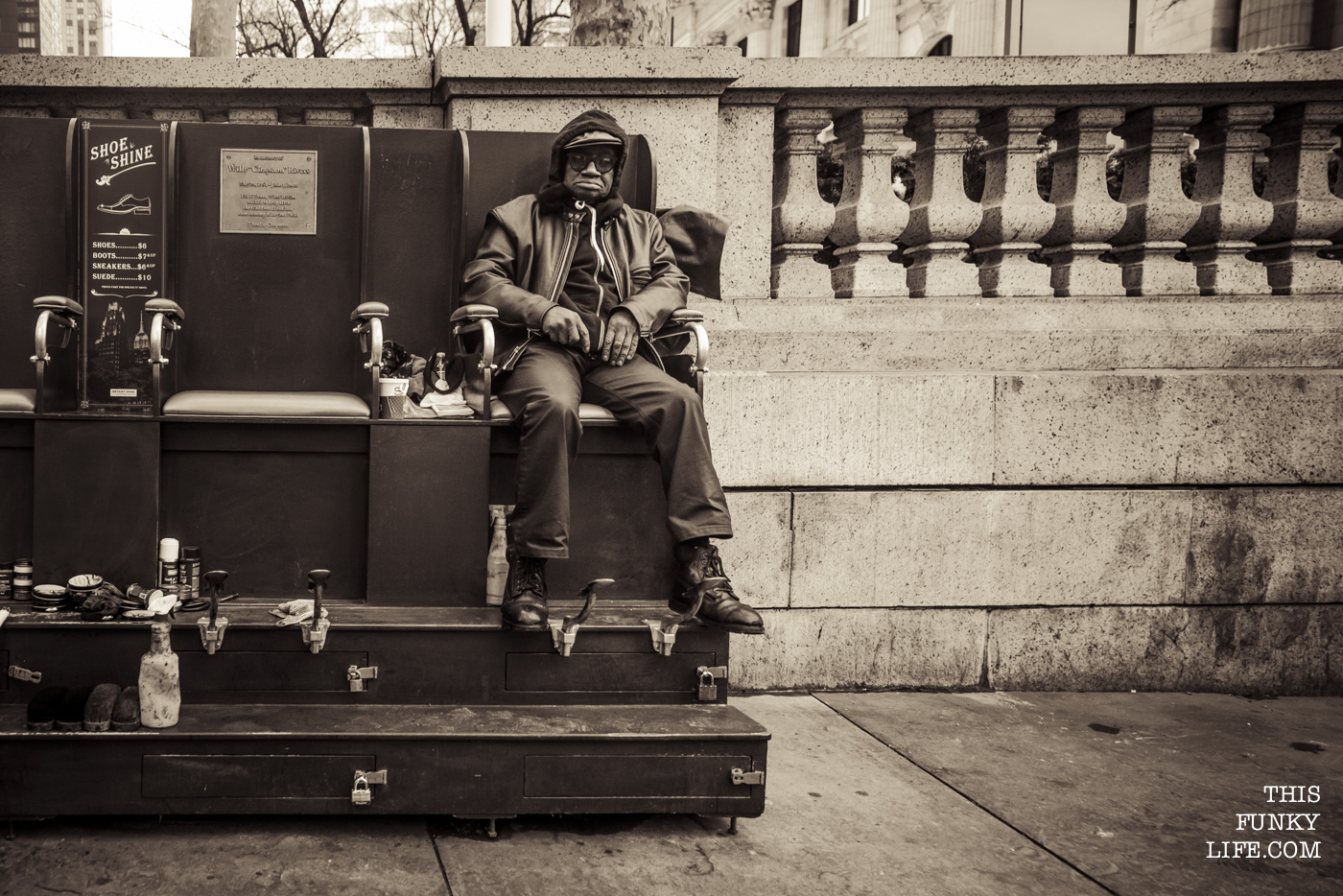 A Shoeshiner, tiredly gazing at bypassers in Manhattan