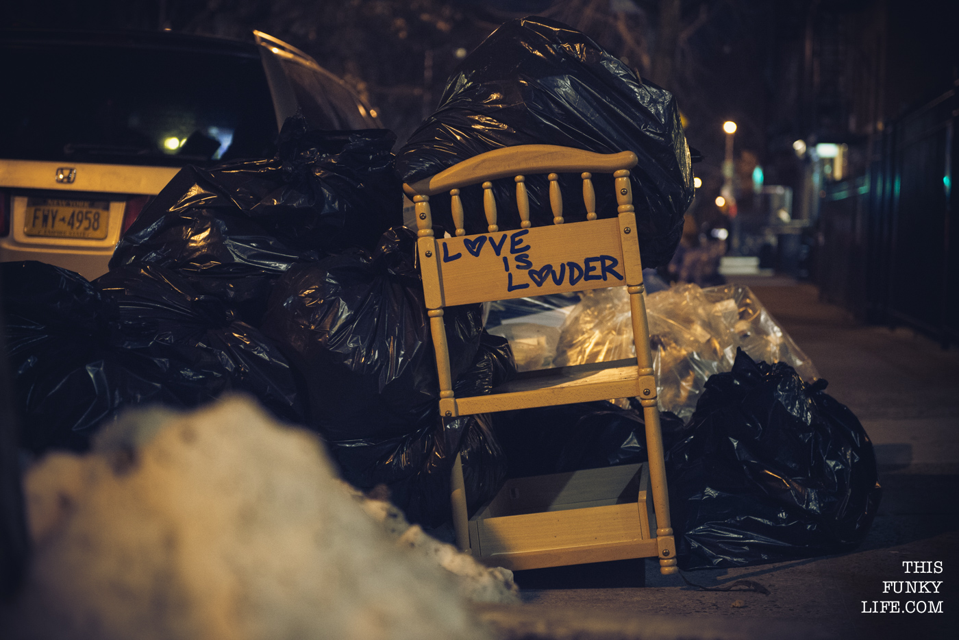 Love Is Louder, it said on a crib put into the dumpster