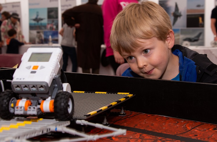 William Moore, 4 years old from Taunton learing about Robotics in the Imagineering tent (small).jpg