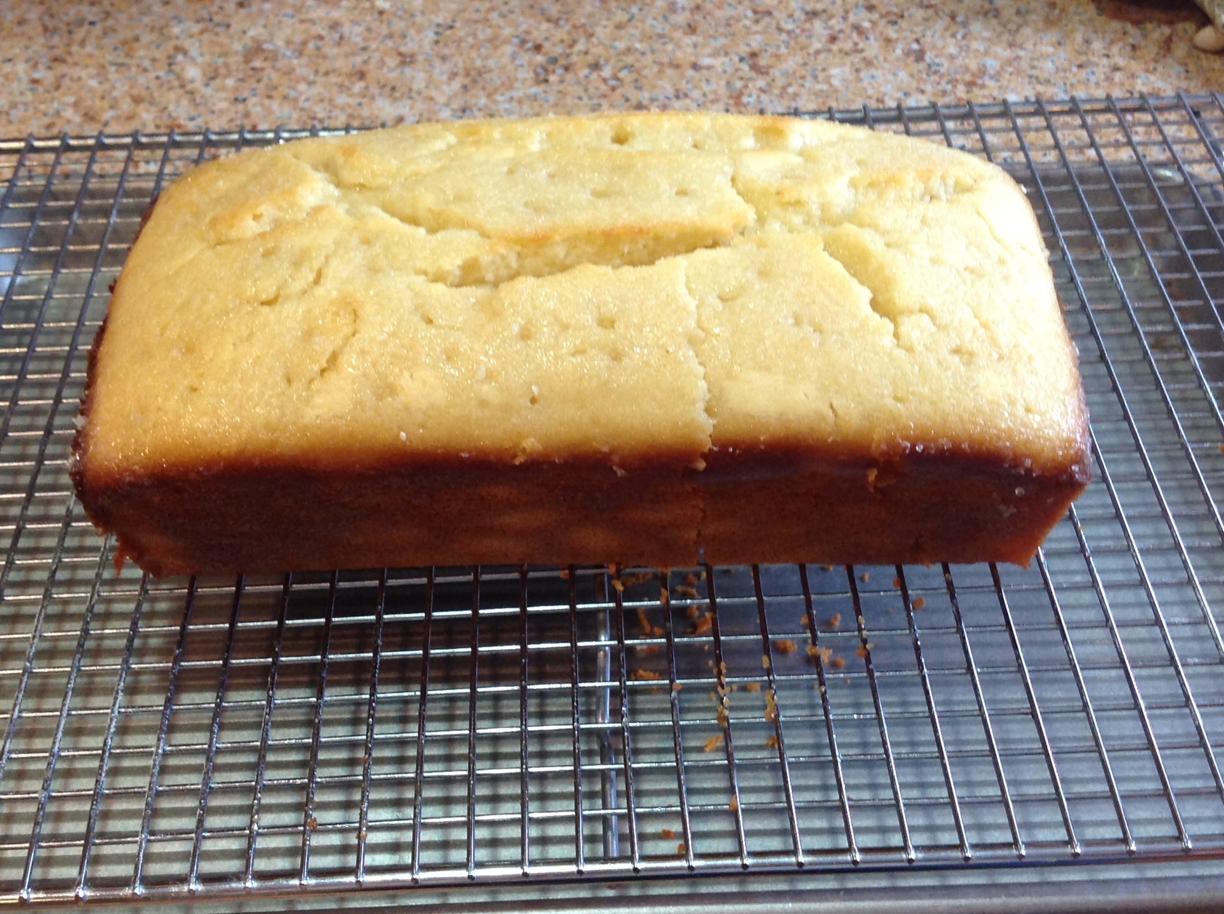 Lemon bread glazed and cooling before slicing.