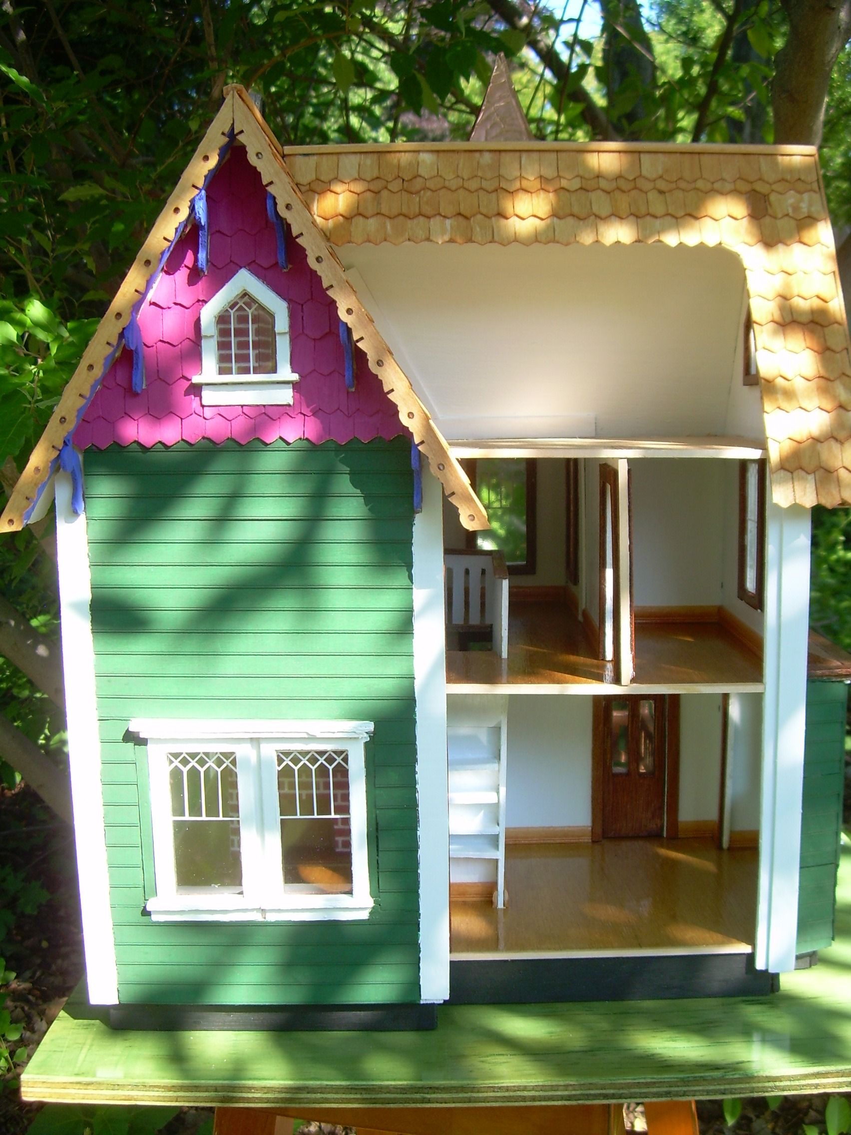 Back view of dollhouse, showing kitchen, upstairs with bath and attic