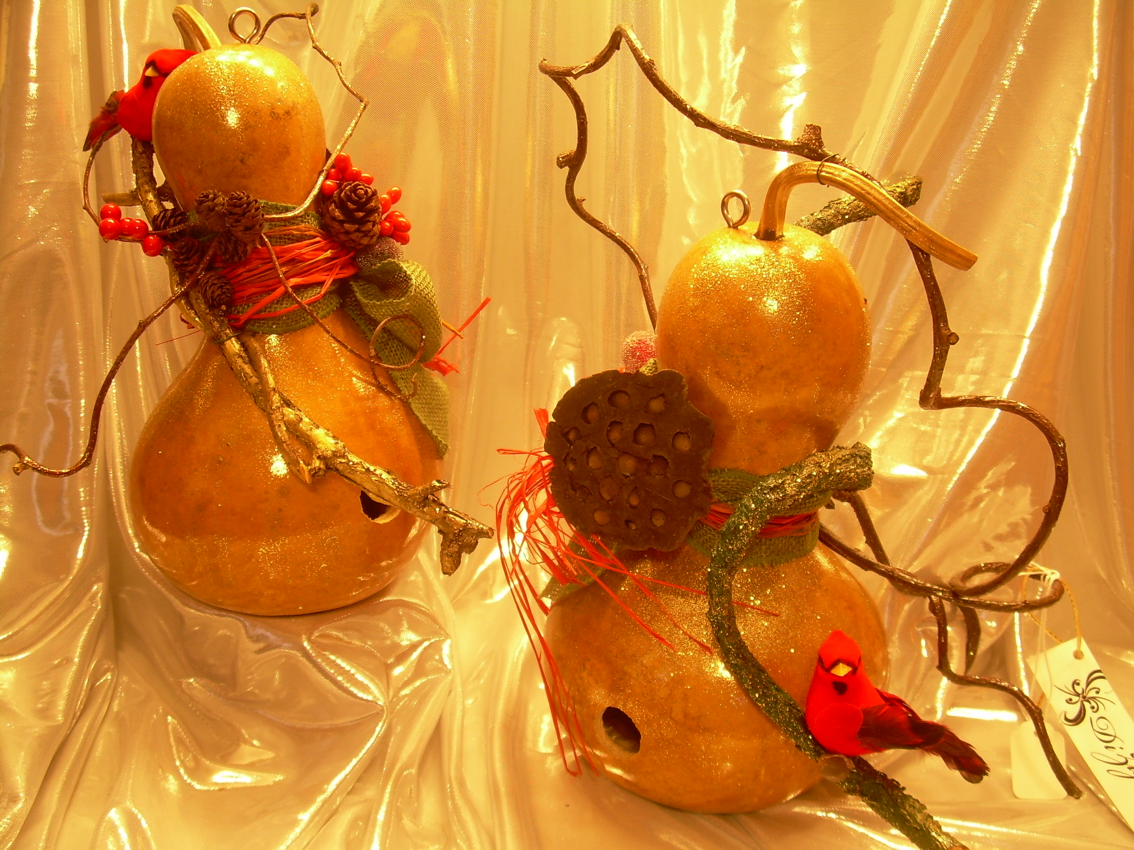 Larger gourds with holes to be used as birdhouses and decorated for the holidays
